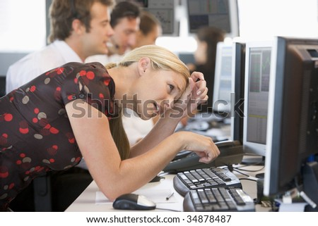 Woman Looking At Monitor Frustrated