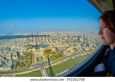 Woman looking at Panoramic View from the top of Eiffel Tower, Paris, France - stock photo