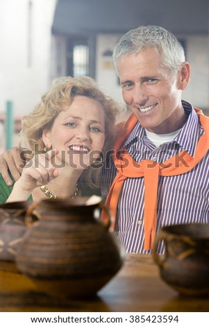 Woman looking at pottery