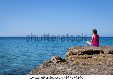 Woman Looking at Sea in an Old Dock, Mallorca - stock photo