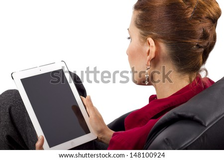 woman looking at tablet computer (blank screen for composites) - stock photo