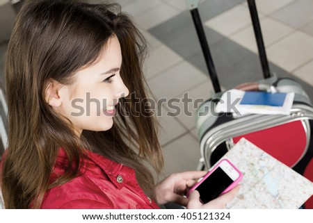 woman looking at the map and telephone number. She is studying the route. Close-up. - stock photo