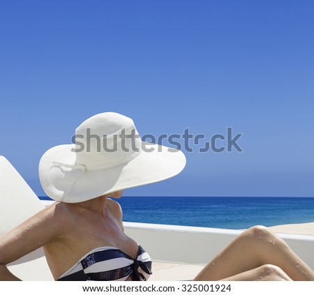 Woman looking at the ocean in Punta Cana - stock photo