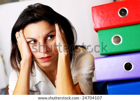 woman looking at the office folders. - stock photo