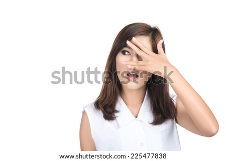 woman looking between fingers,Girl covering her face with her hands and peering out with one eye between her fingers,Portrait of beautiful young asian woman,human emotions,isolated on white background - stock photo