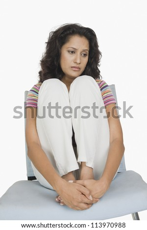Woman looking depressed - stock photo