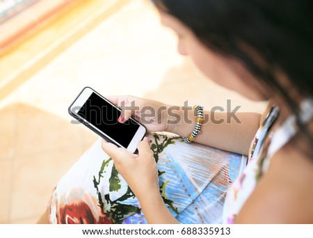 woman looking her smart  phone