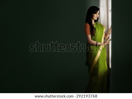 Woman looking out of a window - stock photo