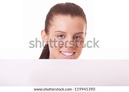 woman looking out of blank board on white background - stock photo
