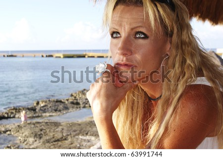 Woman looking out over ocean - stock photo