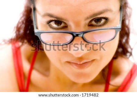 Woman looking over glasses. - stock photo