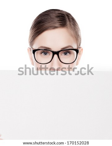 woman looking over top of white sign  - stock photo