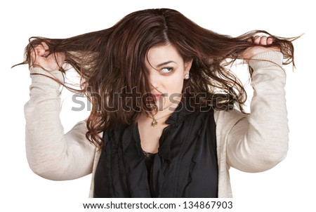 Woman looking over while pulling messy hair
