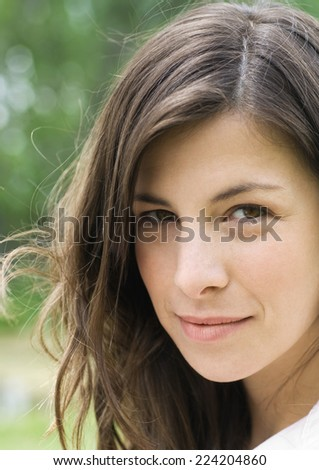 Woman looking sideways at camera, portrait