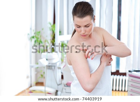 woman looking suspicious mall in hospital room - stock photo