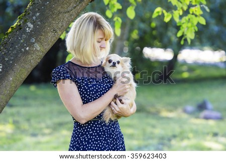 Woman looking tenderly at her sweet baby-dog
