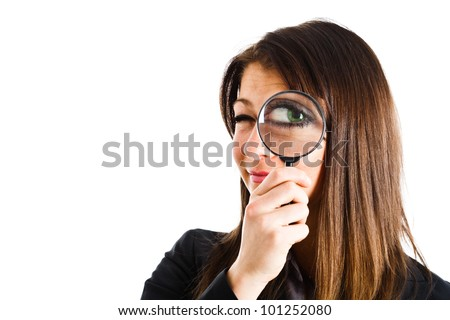Woman looking through a lens isolated on white - stock photo