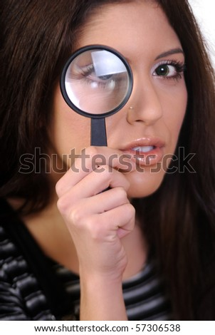 Woman Looking Through A Magnifying Lens