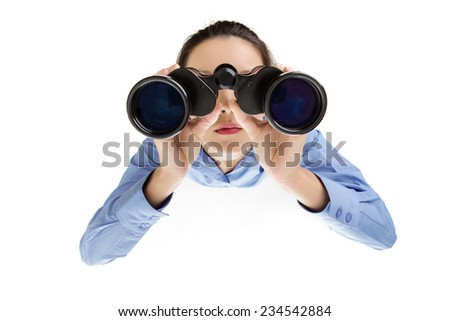 woman looking through binoculars shot from a birds eye view looking down - stock photo