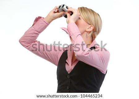 Woman looking through binoculars up. Side view - stock photo