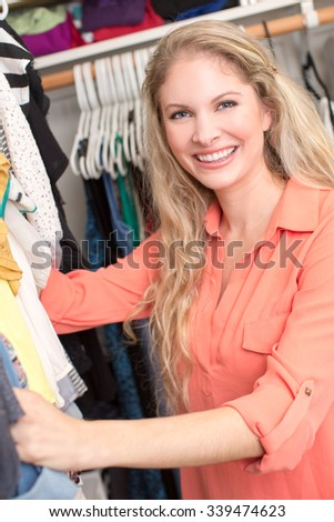 Woman looking through clothing in closet