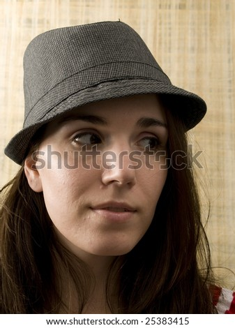 Woman Looking to the Side in Fedora