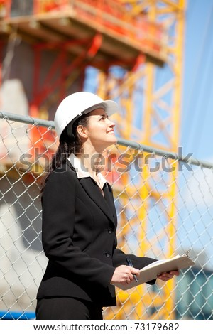 Woman looking up at construction site - stock photo