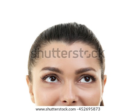 Woman looking up on white background