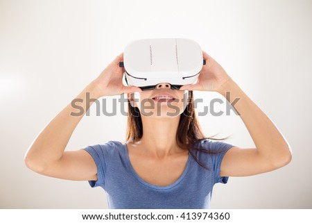 Woman looking with VR device