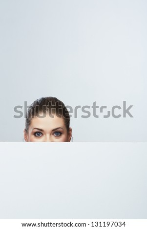 Woman looks out of pure billboard. Isolated.