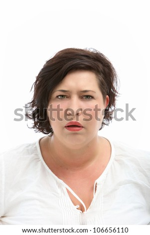 Woman looks stupid and questioning - cutout on white - stock photo