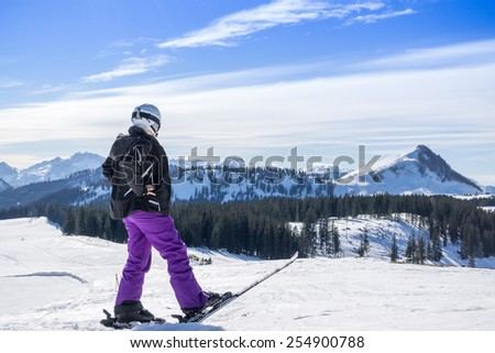 woman looks to the winter landscape - stock photo
