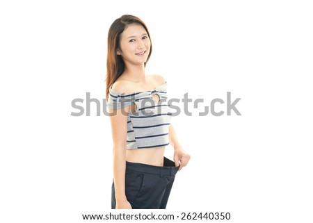 woman lost weight on the diet - stock photo