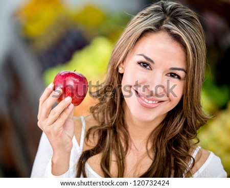Woman loving healthy eating buying fruits at the grocery shop - stock photo