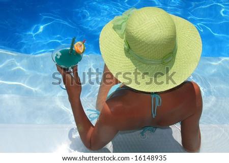 Woman lying in blue pool - stock photo