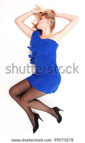 woman lying lovely girl in blue dress over white background - stock photo