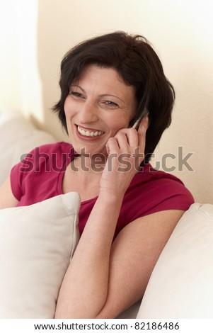 woman lying on a sofa - stock photo