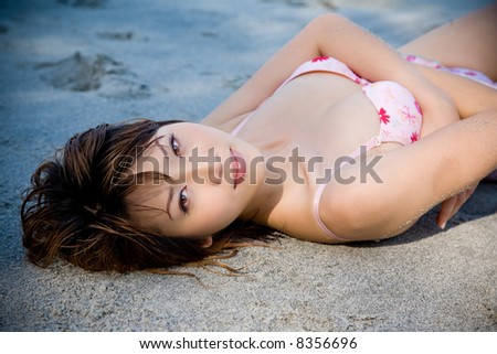 woman lying on the beach smile gracefully