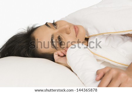 Woman lying on the bed