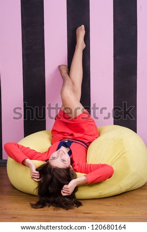 Woman lying on the yellow couch