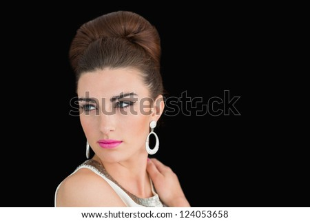 Woman made up in a sixtes mod style on black background - stock photo