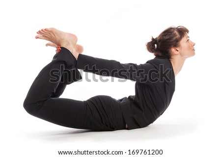 Woman maintaining work life balance in a yoga pose. Shot in studio, isolated on white. - stock photo