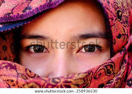 woman makeup on eyes hidden her face with shawl