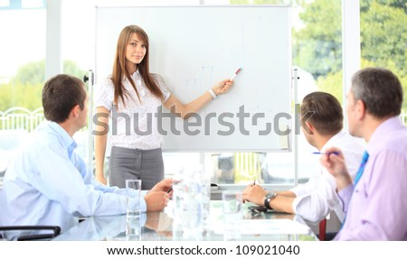 Woman making a business presentation to a group - stock photo