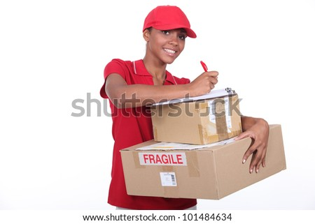 Woman making a delivery - stock photo