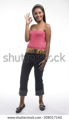 Woman making a hand gesture - stock photo