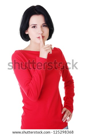 Woman making a keep it quiet gesture , isolated on white - stock photo