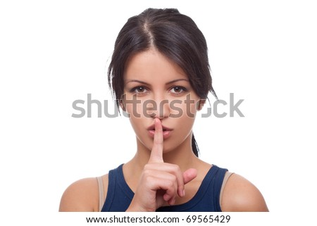 Woman making a keep it quiet gesture - isolated on white background - stock photo