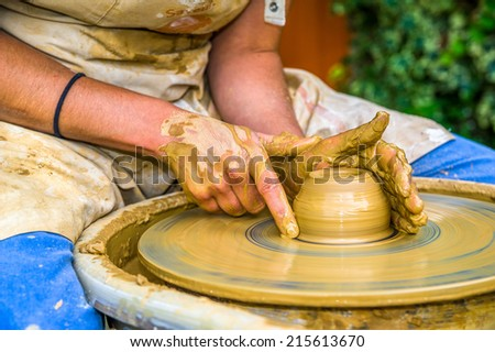 woman making a new pot at her workshop - stock photo