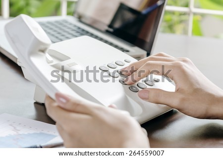 woman making a phone call in office